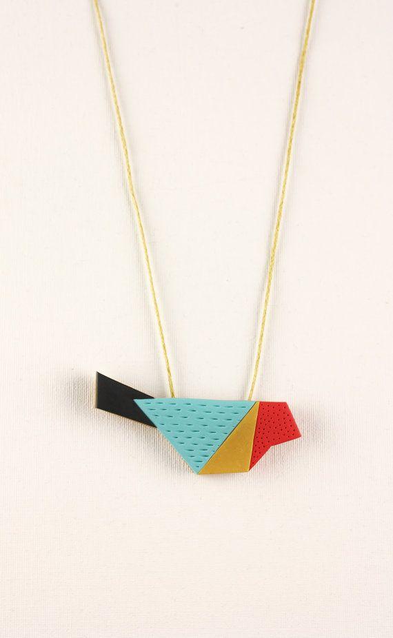 Lindo colar de pássaro geométrico em biscuit (reprodução do site: etsy_debroervandevogel)